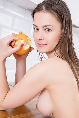 Sojie Exposing Her Shaved Pussy As She Snacks On Fruit